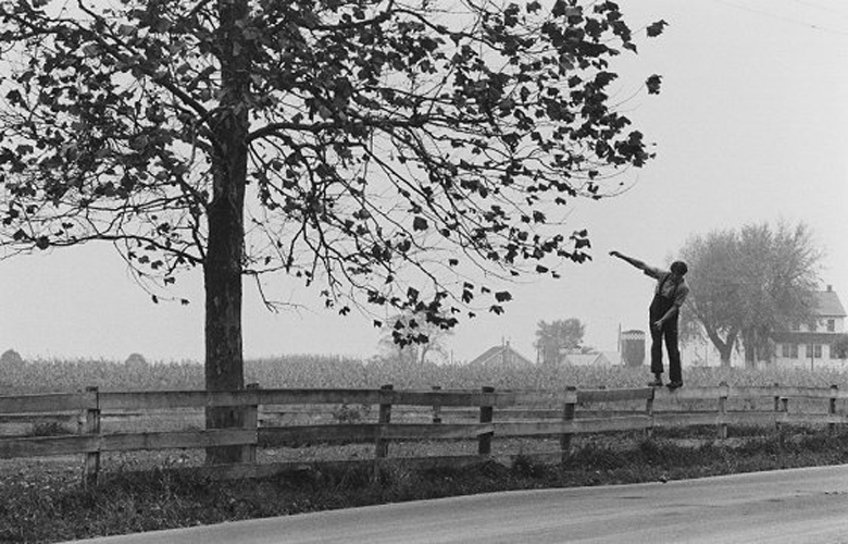 Amish Boy Walking on Fence, Lancaster, PA